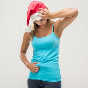 woman-bloated-at-xmas-low-sugar-christmas-by-healthista.com_-300x300