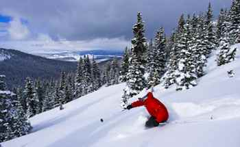 Holly Walker skiing powder in the trees at Winter Park Colorado
