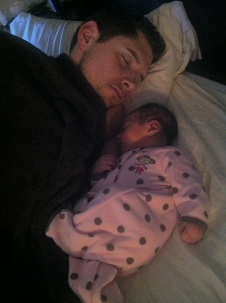 baby Livi snuggling with dad